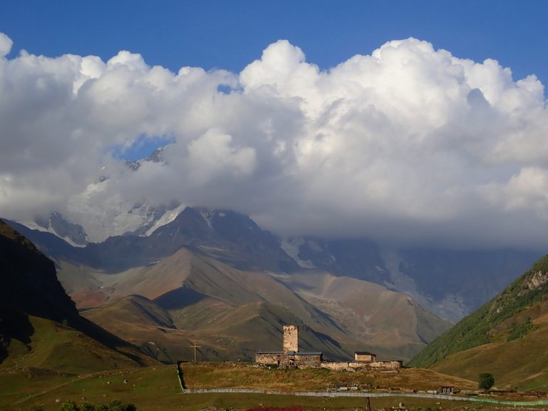 located near the foot of Shkhara, one of the highest summits of the Greater Caucasus Mountains.