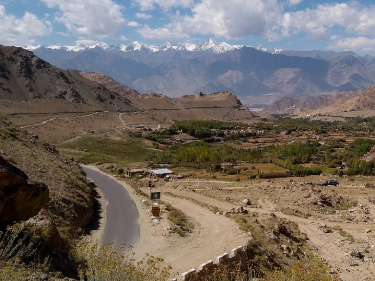 Stok Kangri Range in the background, Leh in the bottom of Indus valley and famous road to Khardung La in the middle.