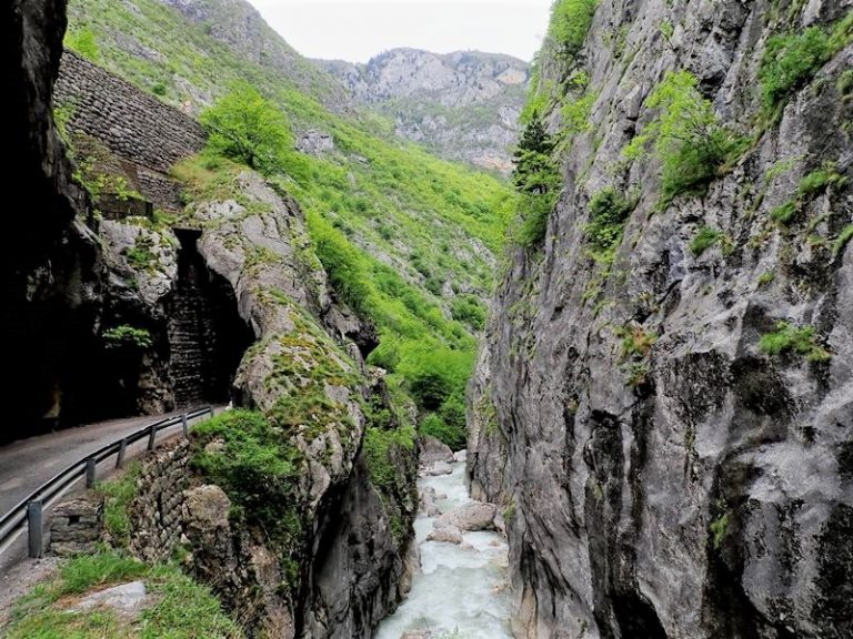 Colossal granite walls vault 600 m above the Bistrica  river, waterfalls and caves at the foot of Prokletije Mountains.