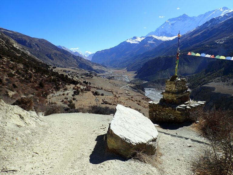 After 2 000 high meters downhill Manang view opened,... with Annapurna II and Annapurna IV.