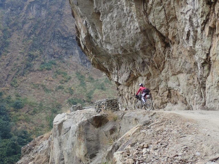 Steep rocky slopes and dangerous road,  but not for bikers :)