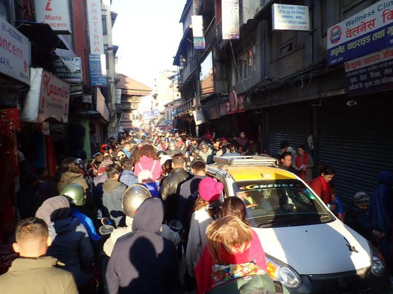 It is an advantage of being one head higher in the crowded streets of Kathmandu :)